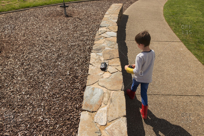 Boy playing with remote controlled car