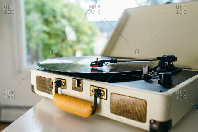 Retro portable record player on a table