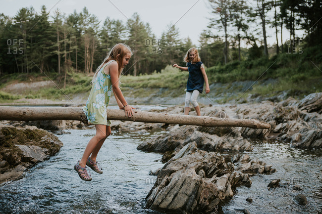 Two girls playing on a river