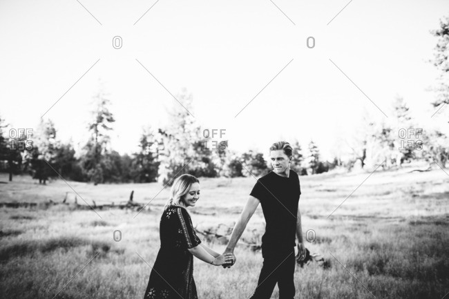 Couple strolling in a field together