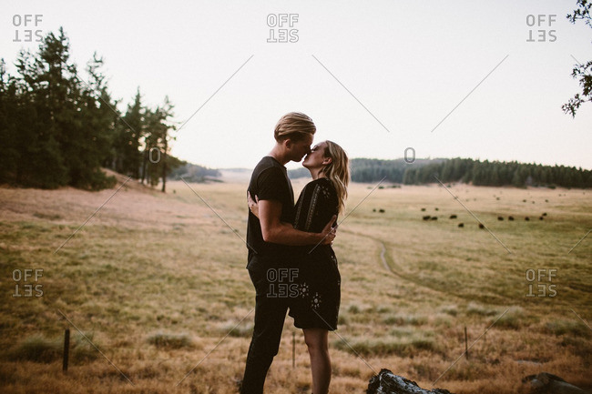Loving couple standing face to face