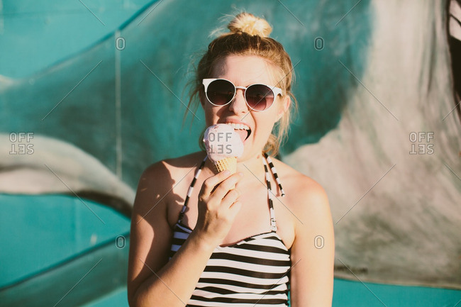 Woman in bathing suit eating ice cream
