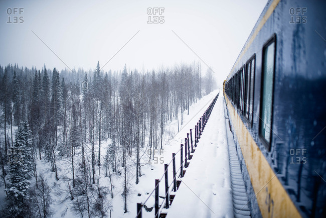 Train traveling in rural winter setting