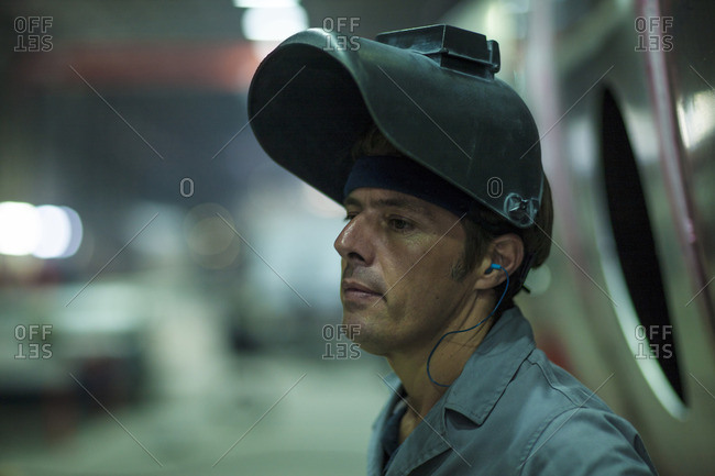 Close-up of a factory worker wearing protective mask