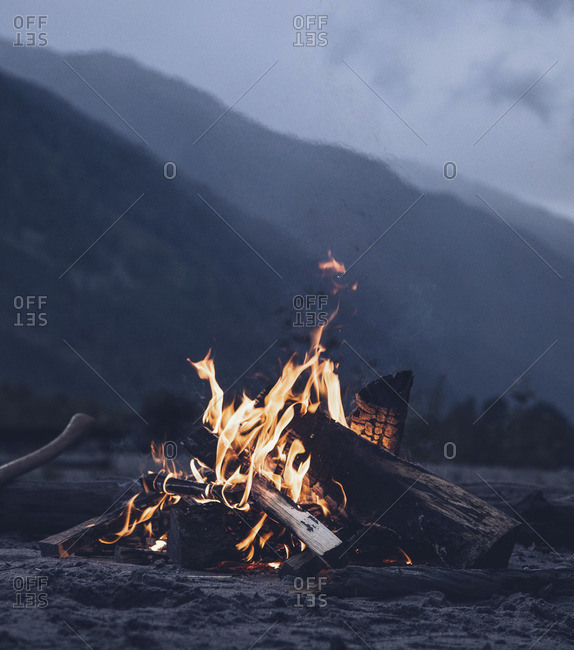 Campfire at dusk in a mountain environment
