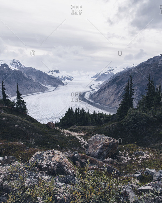 Scenic view of glacier between two mountain ranges