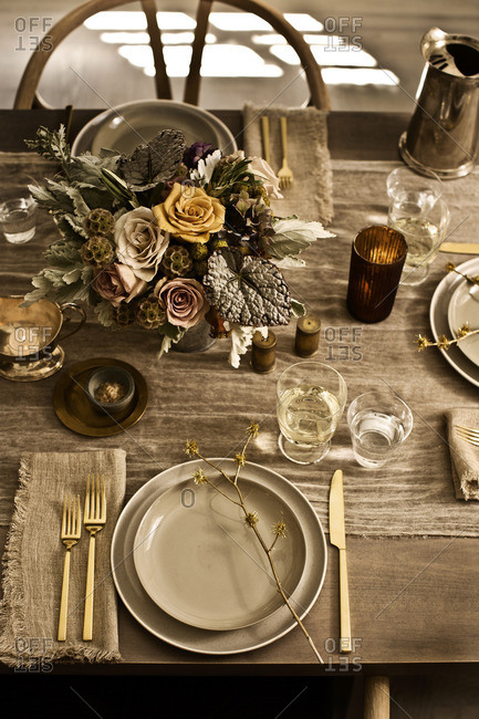 Place settings with floral arrangement and table runner