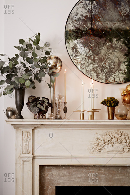 Decorated mantle with lit candles