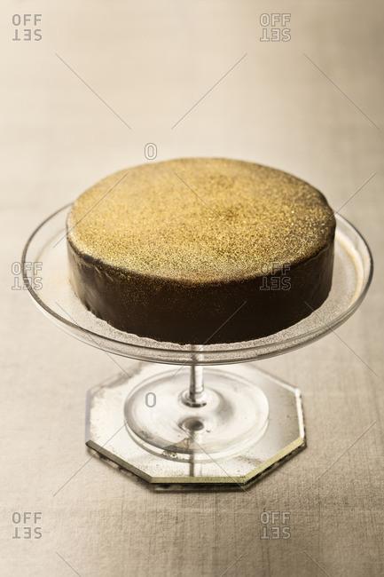 Chocolate cake served on a cake stand