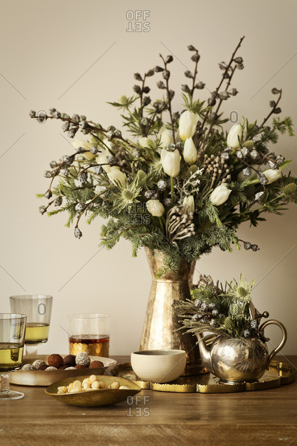 Table setting with floral arrangement and desserts