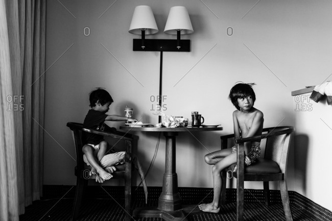 Brothers eating together at a table