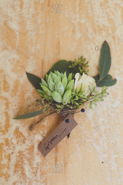 Boutonniere with white rose for a groom