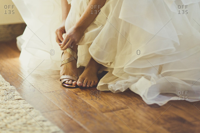 Close-up of a bride buckling her shoe