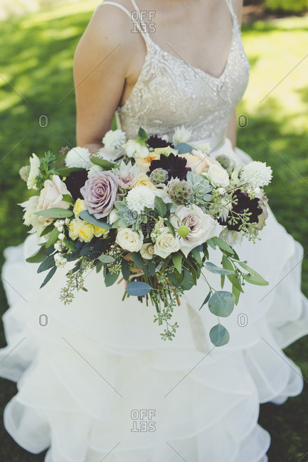 Close-up of a bride holding her wedding bouquet