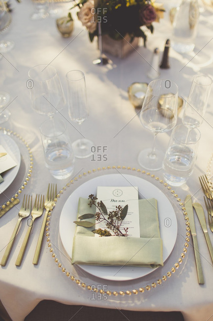 Place setting with menu at a wedding reception