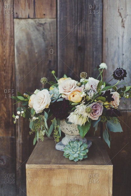 Floral bouquet with roses and succulents in a vase