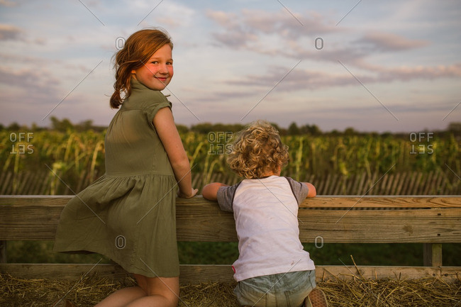 Children on a hay ride looking out over farmland