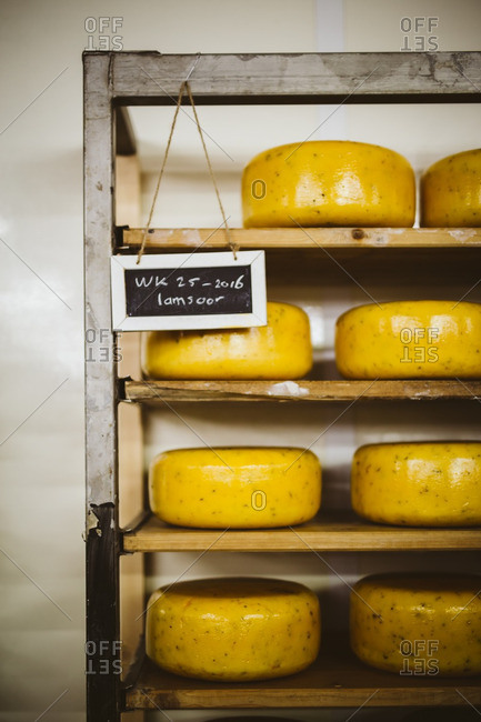 Sign marking shelves of aging cheese