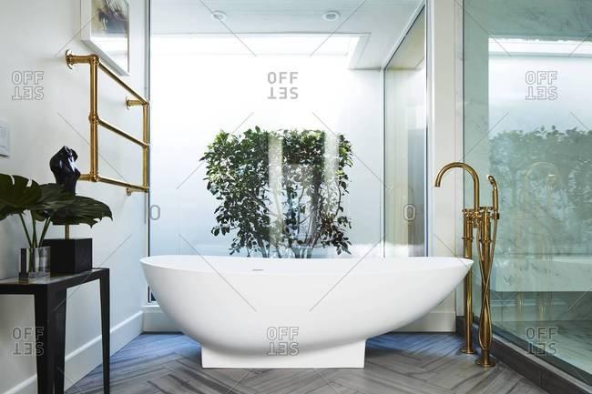Beverly Hills - November 11, 2016: Soaking tub in modern, upscale bathroom