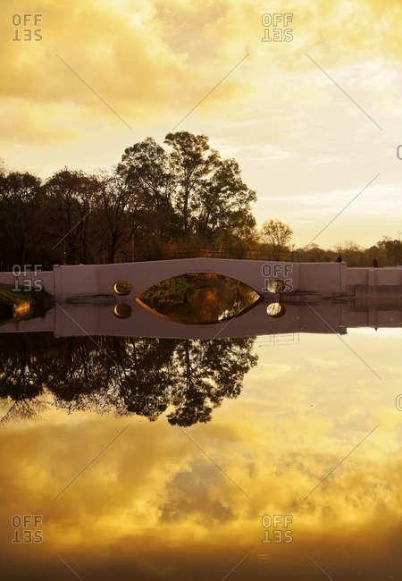 Argentina, Buenos Aires Province, San Antonio de Areco, View of the Areco River and the Old Bridge at sunset.