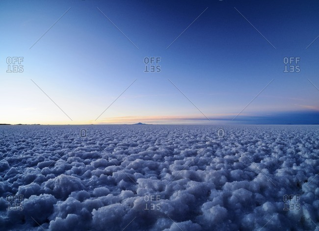 Bolivia, Potosi Department, Daniel Campos Province, View of the Salar de Uyuni, the largest salt flat in the world at sunset.