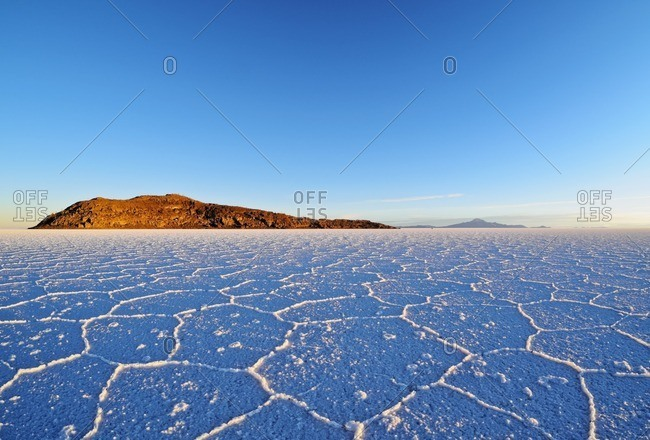 Bolivia, Potosi Department, Daniel Campos Province, Salar de Uyuni, View towards the Incahuasi Island at sunrise.
