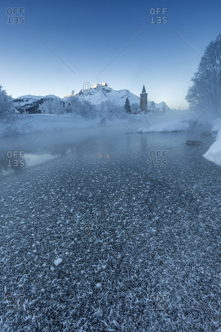 Foggy sunrise in winter. Sils Maria, Sils im Engadin, Graubunden, Switzerland.