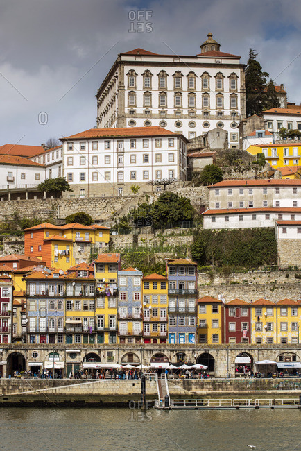 Porto - March 27, 2016: View over the colorful buildings of Ribeira district and Episcopal Palace, Porto, Portugal