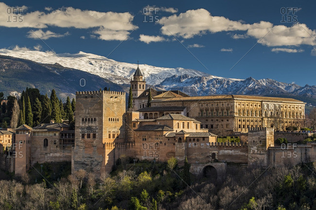 Alhambra palace with the snowy Sierra Nevada in the background, Granada, Andalusia, Spain