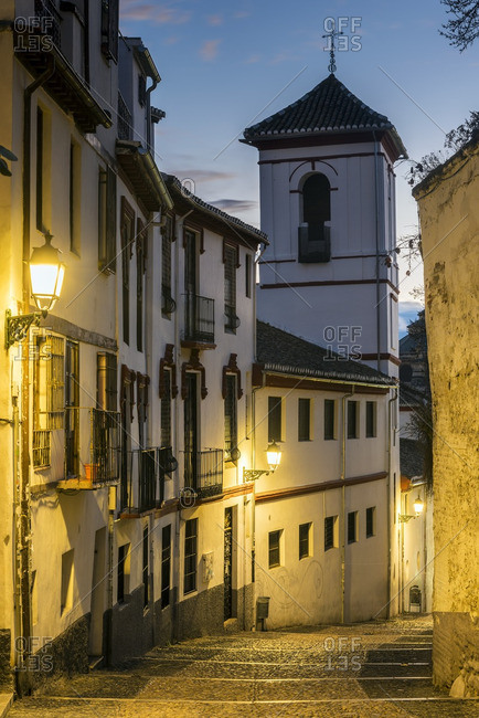 Picturesque view at dusk of a street in the Albayzin district, Granada, Andalusia, Spain