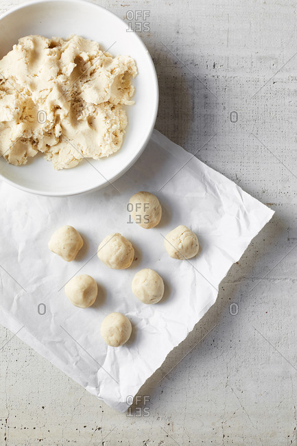 Dough being formed into balls for anise sugar cookies