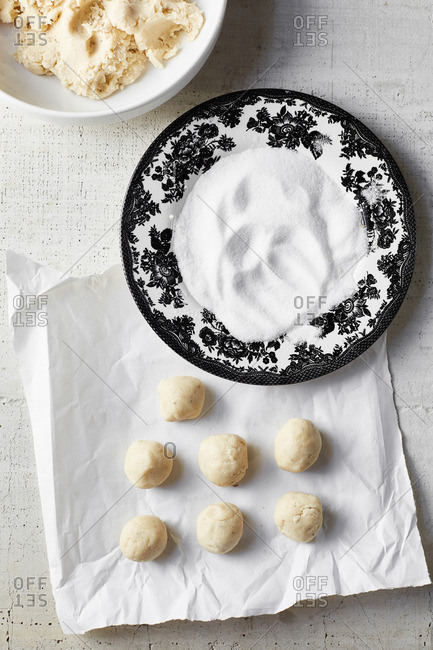 Dough balls and sugar for anise sugar cookies