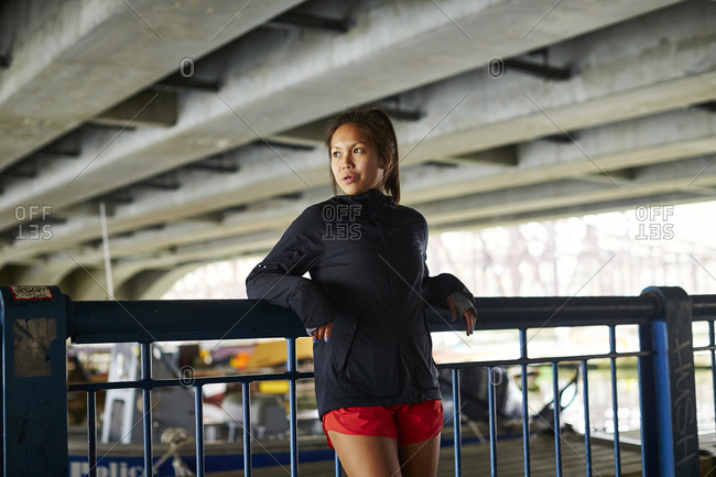Asian American woman in athletic clothing
