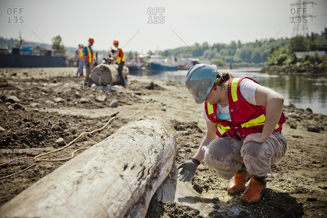 A Woman Checks To See If The Concrete Is Dry On A Job Site