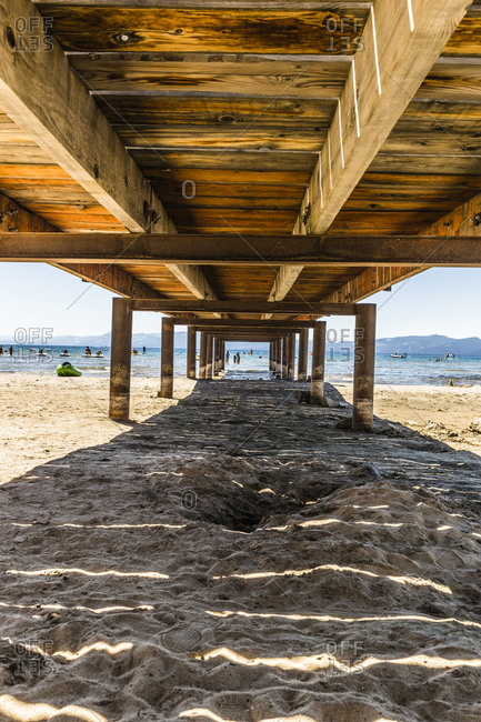 View from under the pier at Kings Beach in North Shore of Lake Tahoe