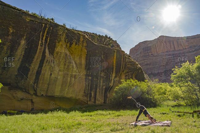 Woman Doing Exercise At Dinosaur National Monument, Utah, Usa