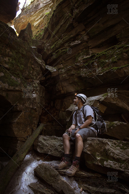 Man Exploring The Ellenville Fault Line Ice Caves In Ellenville, New York, Usa