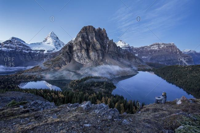 Man Overlooking Lake At Mount Assiniboine Provincial Park, British Columbia, Canada