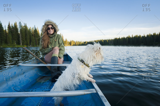 Smiling Girl And A Dog In A Boat At Lake Irwin