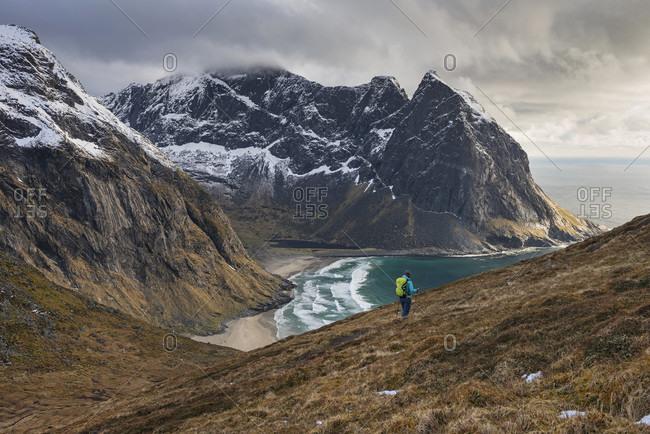 Female Hiker Hiking Near Kvalvika Beach In Moskenesoy, Lofoten Islands, Norway