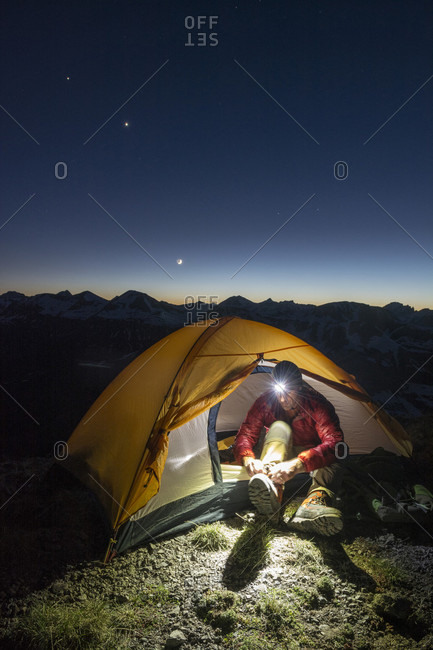 A Man Camping On The Molas Pass Above The San Juan National Forest During Night In Durango, Colorado
