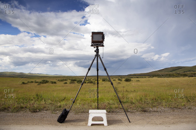 A Large Format Camera Overlooking Grassy Land In Alberta