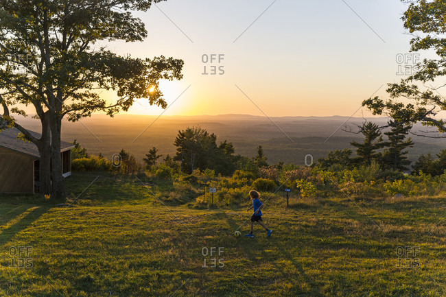 Kids Playing In A Field On The Summit Of Mount Agamenticus In York, Maine