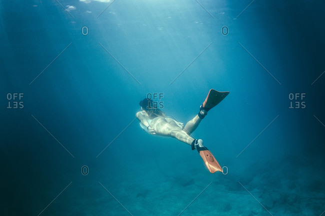 Underwater View Of Girl Snorkeling
