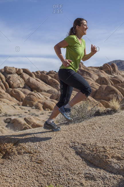 Woman Trail Running In The Alabama Hills National Recreation Area, Lone Pine, California, Usa