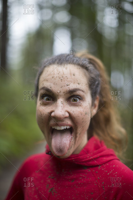 Portrait Of A Female Trail Runner With Mud On Her Face