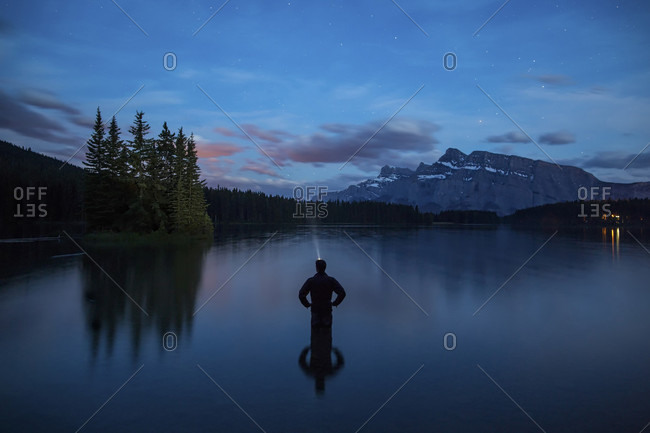 Silhouette Of Person Standing In Two Jack Lake, Banff National Park