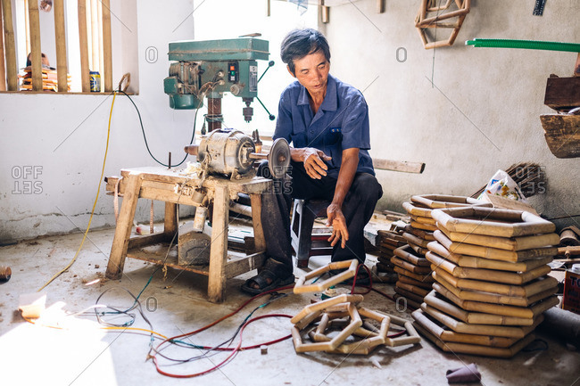 Hoi An, Vietnam - January 20, 2016: Man in a woodworking shop