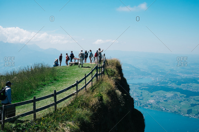 Brunnen, Switzerland - August 3, 2015: Tourist overlooking Swiss landscape from Mount Rigi