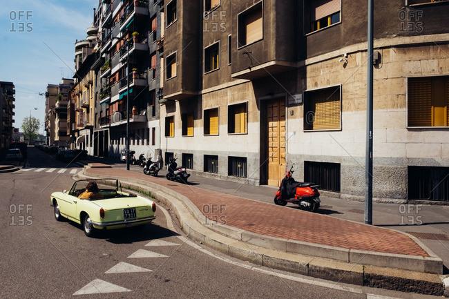 Milan, Italy - April 10, 2016: Green car driving down the streets of Milan